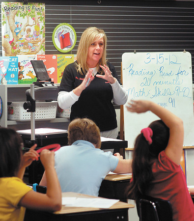 Valley Grove Elementary School Third grade teacher Amy Shepherd goes over their worksheet with her students during Success Time where they prepare for the upcoming IREAD testing.