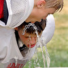 Football camp players cooling off.