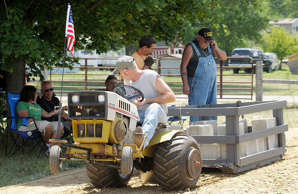 Ed Hancock of Anderson competes in the Garden Tractor Pull at the 4-H Fair on Saturday.