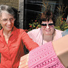 """Zola Noble and Kim Ousley are """"yarn bombing"""" all the Walking Man statues."""