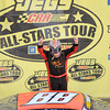 Trent Snyder emerges from his car and gestures to the crowd after taking the checkered flag in the JEGS/CRA All-Stars Tour 100 lap race at the Anderson Speedway on Friday.