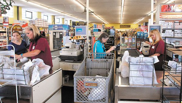 Shoppers check out at the Harvest Supermarket at 8th & Scatterfield Road.