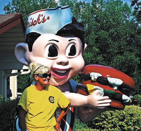 Frisch's owner Lee Ann Lehman with the iconic Big Boy statue which has been restored to its original 1959 appearance.