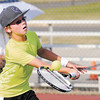 Matthew Etherington, 12, returns a volley to Garrett Dalton, 9, during their Boys 12 & Under singles match on opening day of the 33rd annual Community Hospital Anderson Tennis Classic on Saturday.