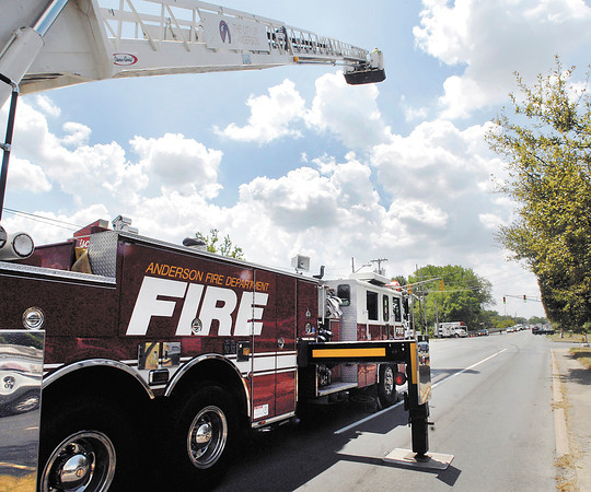 APD continued their investigation Tuesday afternoon into fatal accident at Broadway & Grand Ave.the night before.  They asked for the fire department's ladder truck so they could get aerial shots from the platform over the intersection of the accident.