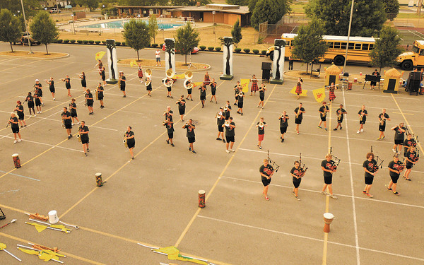 """The Anderson High School Marching Highlander's perform their show, """"Expdition Africa,"""" for parents on Tuesday. The band will be competing Thursday at the Delaware County Fair and again Saturday at Muncie Southside."""