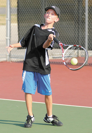 Garrett Dalton, 9, returns a volley to Matthew Etherington, 12, during their Boys 12 & Under singles match on opening day of the 33rd annual Community Hospital Anderson Tennis Classic on Saturday.