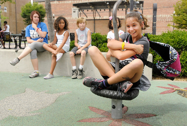 Gabriella Boles spins on the playground equipment at Town Center Park on Tuesday.