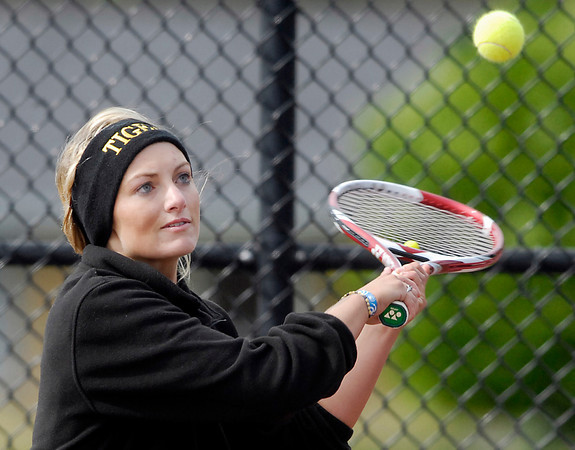 Michelle McFarran, of Alexandria, hits a backhand during her match with Madison-Grant Monday afternoon.
