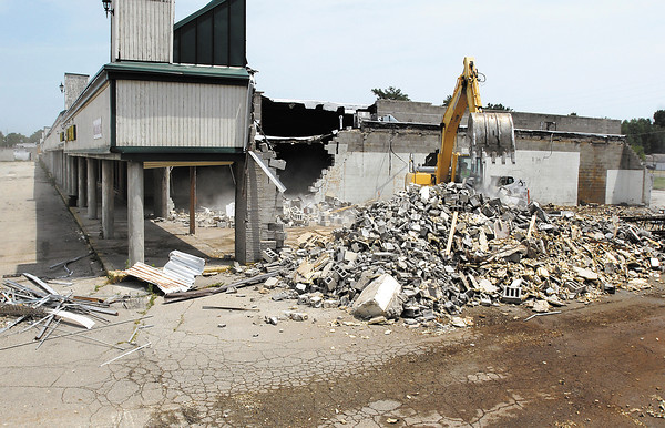 Demolition started Monday on the old Edgewood Plaza on Nichol Ave. in Anderson.  Rhino Trucking & Excavating is doing the work.