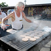 James Marshall cooks hamburgers and hot dogs during a fundraiser for Operation Love at the Harvest Market on Columbus Avenue on Friday. The fundraiser will continue today selling a drink and hamburger or hot dog for $1.50.