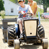 Cian Rice, 13, of Alexandria competes in the Garden Tractor pull during the 4-H Fair on Saturday.