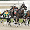 Raise The Gin, driven by Trace Tetrick, makes his move down the stretch to win the second race on the last night of live standardbred racing at Hoosier Park Saturday evening.