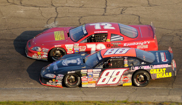 Trent Snyder (88) passes Thomas Woodin (72) for the lead on lap 13 of the JEGS/CRA All-Stars Tour 100 lap race at Anderson Speedway on Friday. Snyder would go on to win the race.