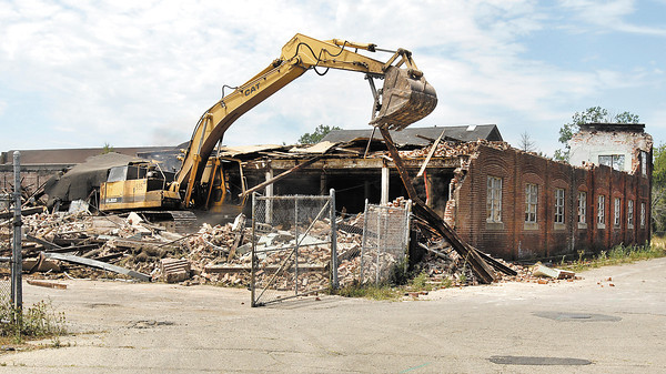 A.M.R. Demolition continues working on razing the old Nicholson File building Monday.  East 34th Street was closed between Columbus Avenue and Clark Street as they started working on the front of the building that runs along the street.