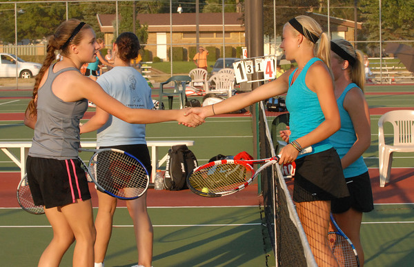 Sidnay Huck shakes hands with Kerrie Ecker after Huck and Scribner defeated Ecker and Sarah Wallace in the doubles match.