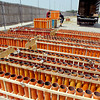 Matt Fisher and John Fraley, of American Fireworks Company, unload approximately 1,000 firing tubes for Wednesday's night fireworks display at Hoosier Park Racing & Casino Tuesday afternoon.  The Anderson Symphony will perform before the 30 minute firework display.