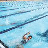 Hannah Boerner, 13, makes her turn as she swims in the Girls 13 & over 100 meter breaststroke finals at the Swim Invitational held at the Dolphin Club where over 500 swimmers participated. Boerner is a member of the ACAC swim club.