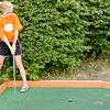 Anna Childers, 10, of Pendleton watches her putt while playing putt-putt with her brother Ethan, 8, at Putt-Putt Golf and Games in the Applewood Centre on Tuesday.