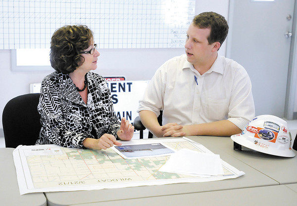 Indiana Senator Vi Simpson, Democratic candidate for Lt. Governor, talks with E.ON project manager Andy Melka about the Wildcat Wind Farm project under construction north of Elwood on Thursday.
