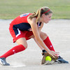 Riverfield's Lauren Landes fields a hit as Riverfield faced Yorktown in the District 6 11 and 12 year old softball tournament at Riverfield Little League on Friday.