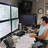 Light and Power Repairman Chuch Lloyd monitors the city's power grid and directs crew as he works in dispatch as Light and Power worked through the night and Saturday restoring power to customers.