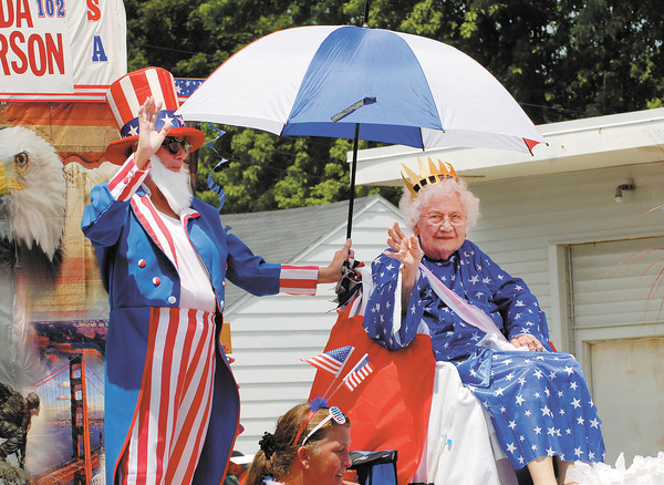 One-hundred-two-year-old Hilda Anderson rides on a float in the Chesterfield Independence Day Parade on Wednesday.