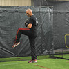 Eli Marshall winds up in the section of the building devoted to baseball. Nets divide the large area into sections that allow several athletes to pitch and hit at the same time.