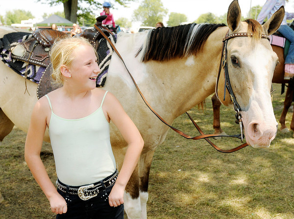 Micah Hardy, 9, from Pendleton and her horse Shasta wait in the shade for their next competition during the Horse and Pony Show at the 4-H Fair on Saturday.