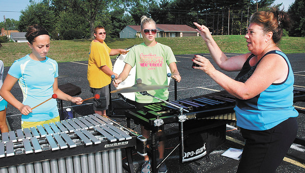 Elwood High School marching bank practicing for State Fair.