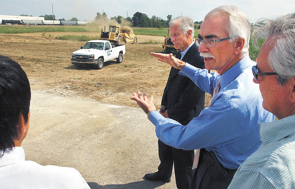 David Bunting, second from right, president of GDI Construction, explains the layout of the GTI plant his company will build, to GTI and Moriroku Technology executives as work on the site has started.  Moriroku Technology is the parent company of GTI.
