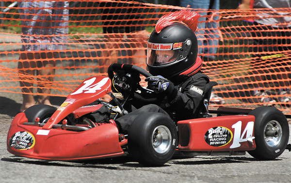 Kaden Wharff, 8, of Brownsburg, with his mohawk helmet, races in his division Saturday in the Alexandria Grand Prix.