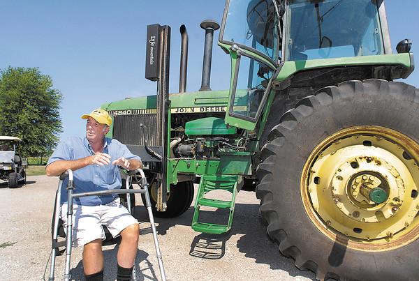 Paralyzed farmer, Mark Hosier, still farming.