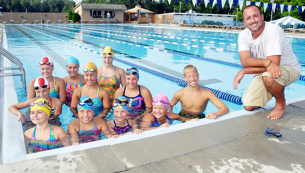 ACAC head coach Todd Griner, right, with 11 of his swimmers that will compete in the Indiana Age Group State Championships.