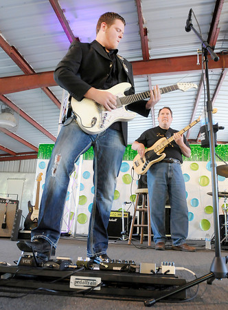 Don Knight/The Herald Bulletin<br /> Zach Day and Full Throttle perform on the stage at the 4-H Fair on Thursday. Woody Wright and Friends will be performing today at 7:30 p.m.