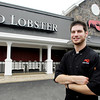 Red Lobster chef Stewart Harrington poses outside the Anderson restaurant where he works.  Stewart appeared in a national Red Lobster commercial.