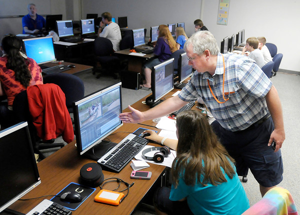 Don Knight/The Herald Bulletin<br /> David Armstrong answers a question for Cheyenne Gibson as <br /> Students learn about editing with Adobe Premiere Pro during Covenant Productions' Filmmakers Camp at AU on Thursday.