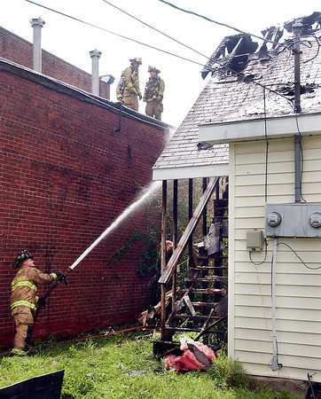 Firefighters battled a blaze in a house at 910 Main Street in Lapel Wednesday afternoon.  There was concern that it might spread to the business next door but firefighters contained the fire to the one structure.