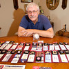 Monty Porter shows off his collection of pins and tickets from every major league ballpark.