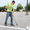 Don Knight/The Herald Bulletin<br /> JB Bilbrey of New Castle paints the lines in the parking lot north of the Kardatzke Wellness center on Friday as AU prepares for Colts Camp. Bilbrey is an incoming freshman who will be studying Christian Ministries.