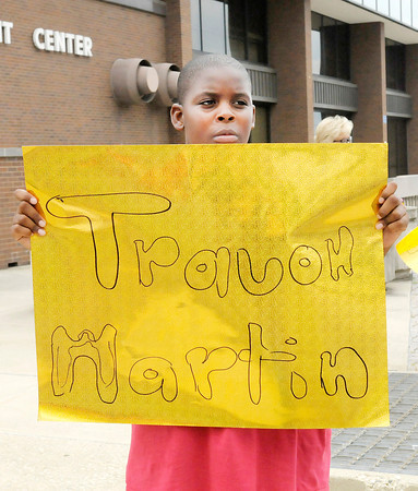 "Don Knight/The Herald Bulletin<br /> Mareon Harris, 11, hold a sign as he protests ""Stand Your Ground"" laws with the group Friends of Trayvon outside the Madison County Government Center on Saturday."