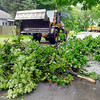 The Anderson Street Department used a large payloader to pick up the pieces of this fallen tree after being cut up in the 2800 block of Dewey Street.  A severe thunderstorm rolled through the area Wednesday afternoon causing power outages, and downed trees with high winds.