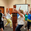 These educators move around the maypole to music and motions that mimic a animal as part of the Orff training program being held at Anderson University's School of Music.