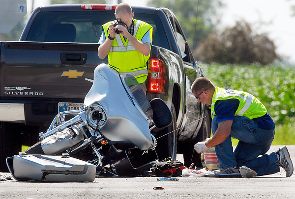Madison County Sheriff Department investigators work the scene of a serious personal injury accident Friday afternoon involving a motorcycle and a pickup truck.  The accident occurred at County Road 1400 North and State Road 13, north of Elwood.