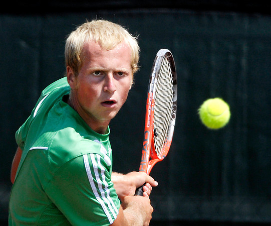 Jack Hiatt concentrates on the ball during his Mens A singles championship match against Alex Poe Saturday.