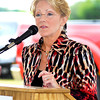 Myers Autoworld president Mary Jamerson speaks to those gathered for the groundbreaking of the development of their new Ford and Buick-GMC dealership buildings in the 2900 block of South Scatterfield Road in Anderson.