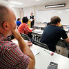 Michael Bradley, of Anderson, goes over his worksheet as instructor Mike Condon goes through the problems on the board during a Algebra II math class at Ivy Tech Community College, Ebbertt campus Monday evening.