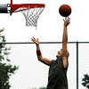 Brandon Ridenour, of Anderson, goes up for a tip-in during an pickup game of basketball at the courts in Pulaski Park Monday evening.