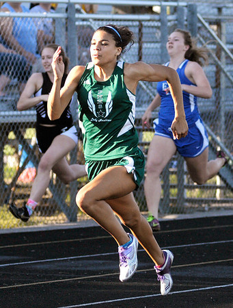 Pendleton Heights' Kiawna Cottrell wins the 100 meter dash during the Girls Track Sectional at Pendleton Heights on Tuesday. Cottrell is the All Herald Bulletin girl's track athlete of the year.
