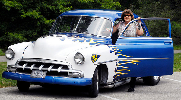 """Noelle Shull with her late husband's, Neal Shull, 1952 Chevy """"The Grey Goose.""""  This year, Kiwanis is honoring Shull by holding the second annual Kiwanis Kar Show in his memory July 13 at Falls Park in Pendleton."""